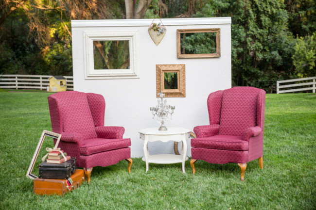 outdoor vintage backdrop with high back chairs and table on grass