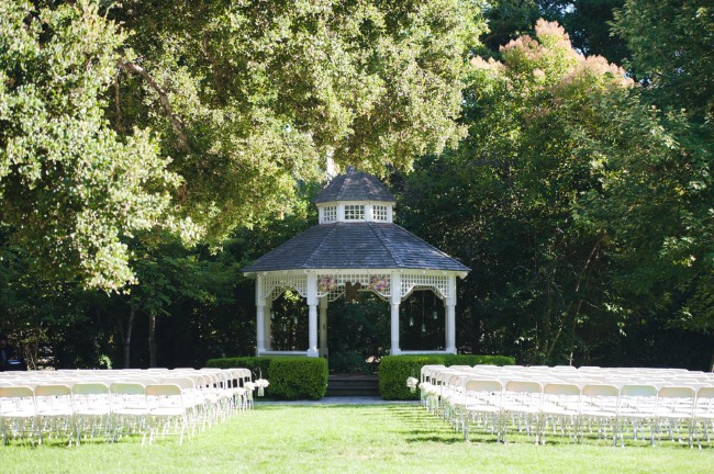 ceremony site with gazebo and rows of white chairs