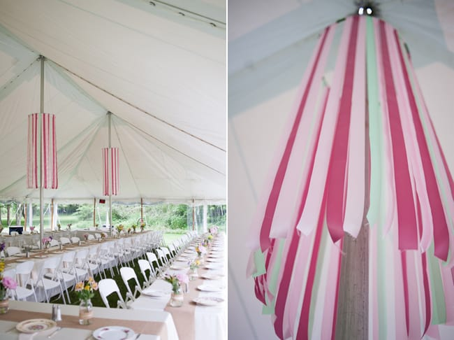 tents with streamers decorating the wedding reception venue