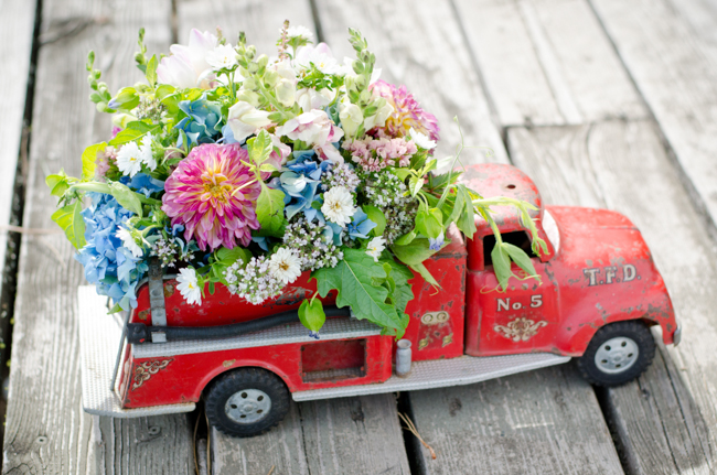 Vintage fire truck with flowers on wooden dock