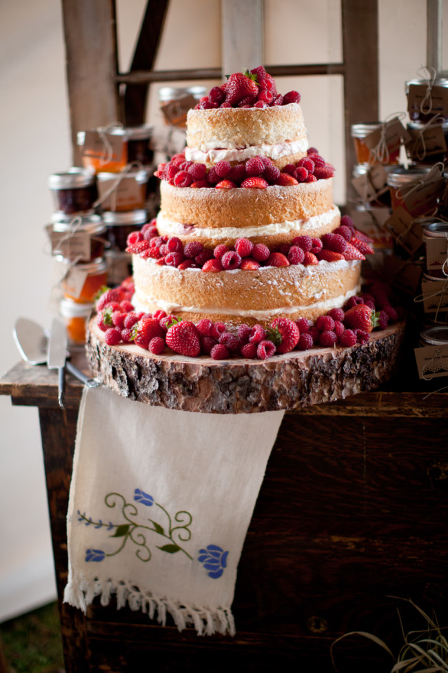 Naked cake with raspberries and strawberries