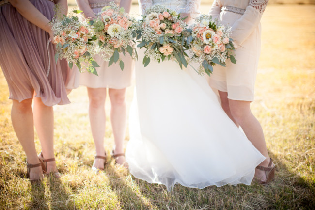 Bridesmaids and Bride holding bouquets up