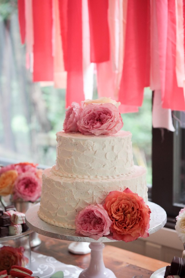 two tier white cake with pink roses
