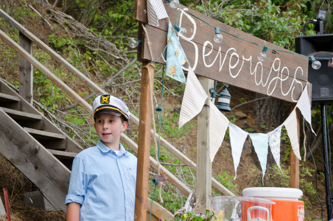 Reception beverage table with wooden beverage sign and bunting