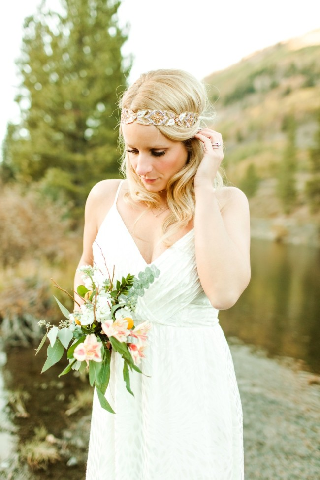 bride with headpiece and bouquet