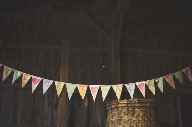 bunting hanging inside wood barn