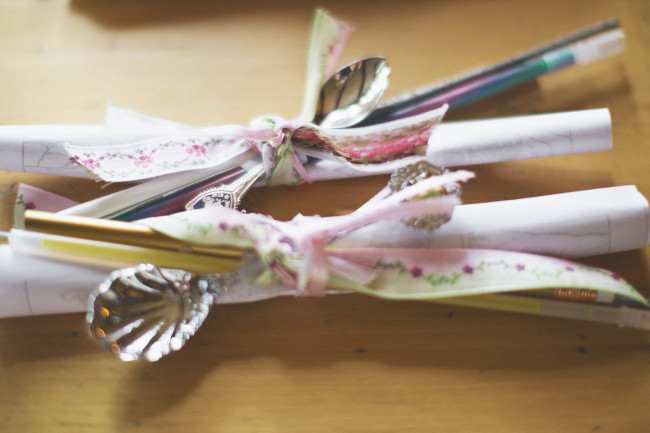 spoons wrapped with ribbon