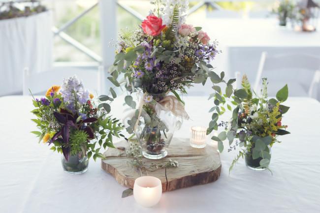 Sunny summery wedding 3 vases on table