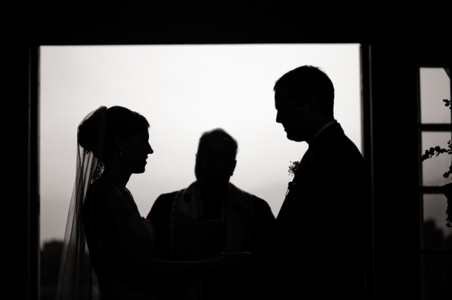 silhouette of bride, groom, and officiant