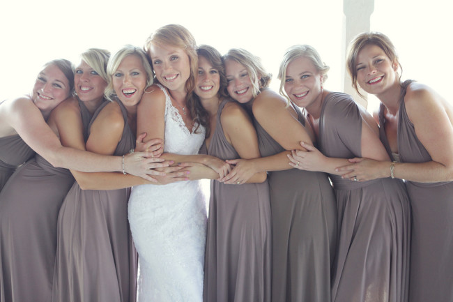 bride and bridesmaids huddle together