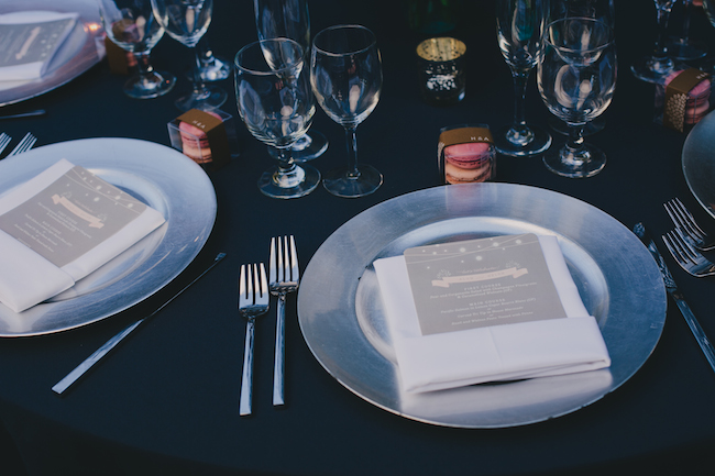 Rustic chic wedding table settings with silver chargers