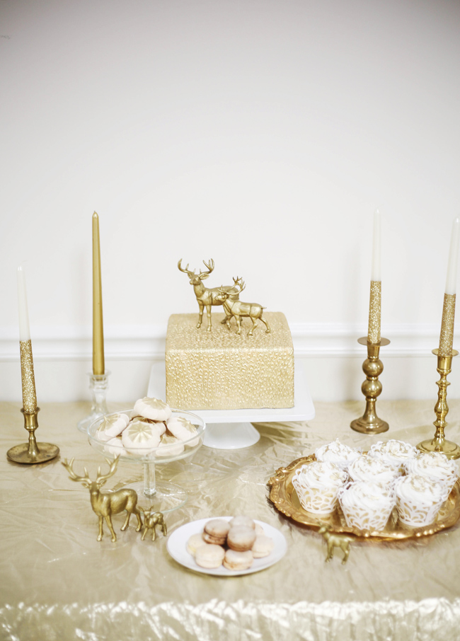 desserts and gold decor on table for styled shoot