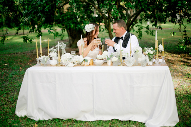 bride and groom toast while seated at outdoor table at Manatee River Garden Club