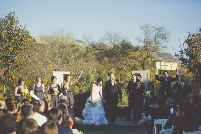 Outdoor wedding ceremony with doors as backdrop