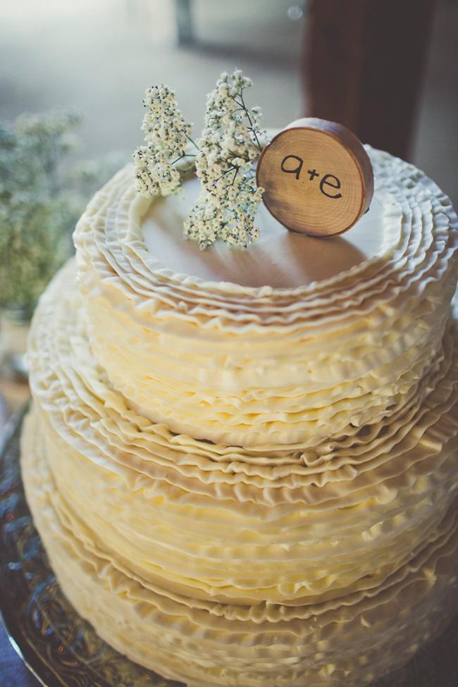 Wedding cake with baby's breath and wood round cake topper