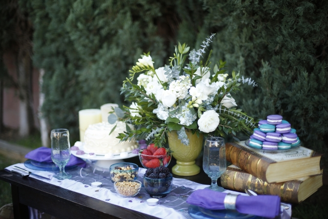 Bohemian inspired styled shoot dessert table - purple and blue macaroons, strawberris, blackberries and cake