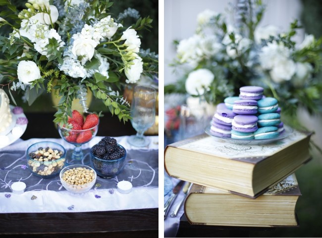 Purple and blue macaroons piled on a plate and resting on large books