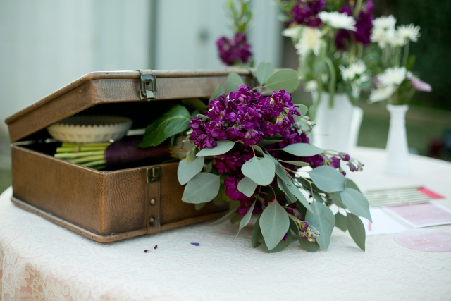 bohemian purple bouquet peaking out of old case