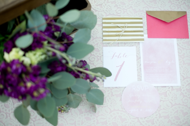 Purple bouquet with stationery on table