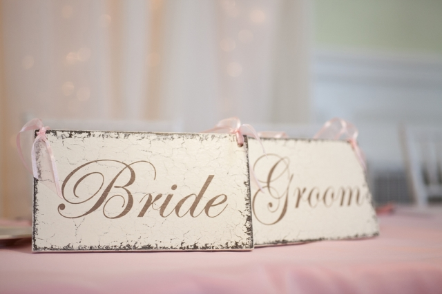 bride and groom placard