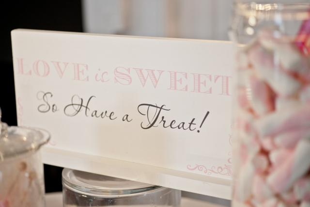 "sign, ""love is sweet so have a treat!"""