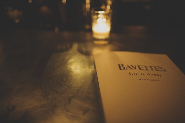 Bavette's Bar & Boeuf  menu with dim candle lighting