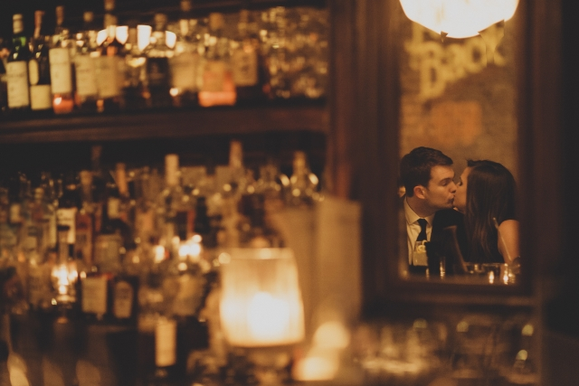 couple kissing can be seen in mirror reflection at Bavette's Bar & Boeuf