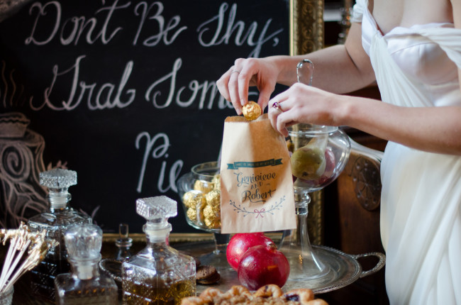 bride putting chocolate into treat bag designed by Fox and Hound Paperie