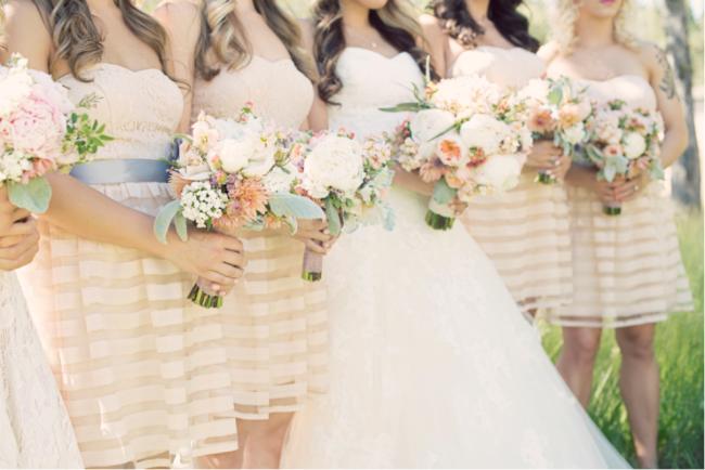 bridesmaids and bride all holding bouquets for leaning tree lodge wedding