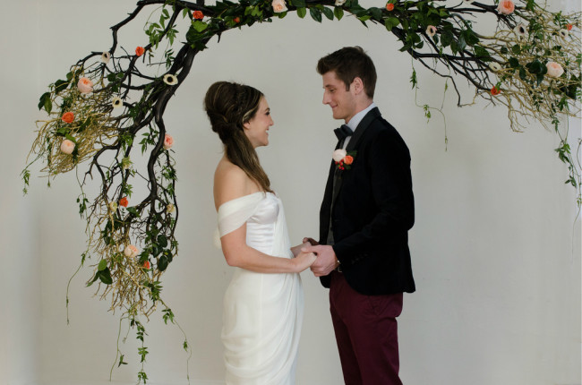 ceremony arch with roses for Woodland Couture styled shoot