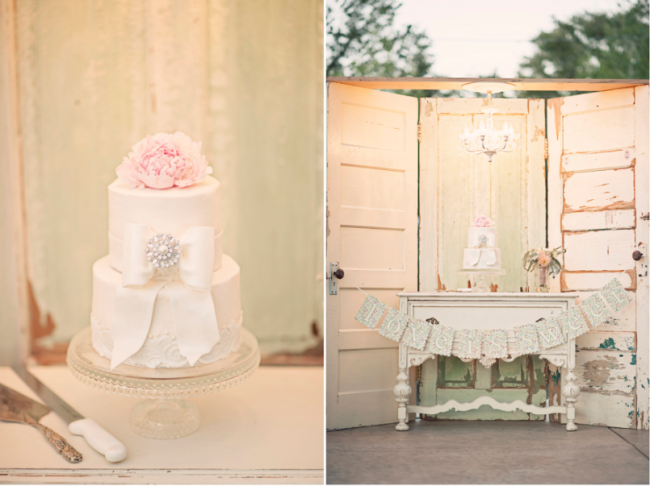 Vintage chic wedding cake set on a dresser, with old wood doors in the background