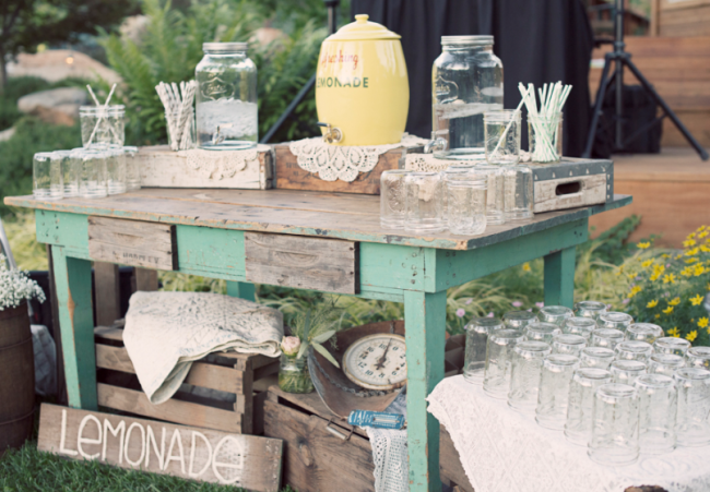 vintage wooden table with lemonade and mason jars at Leaning Tree Lodge wedding