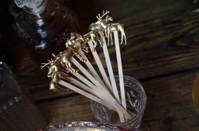 wood stir sticks with gold stags on the end
