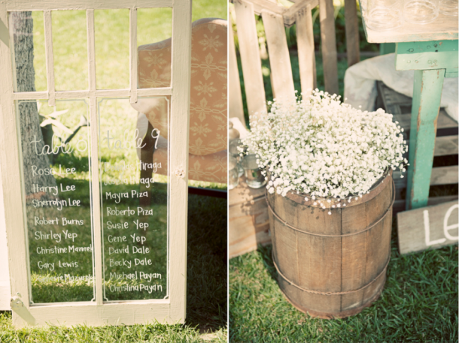 window with white writing on glass along with other outdoor vintage decor at wedding