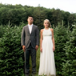 Bride and groom at xmas tree farm