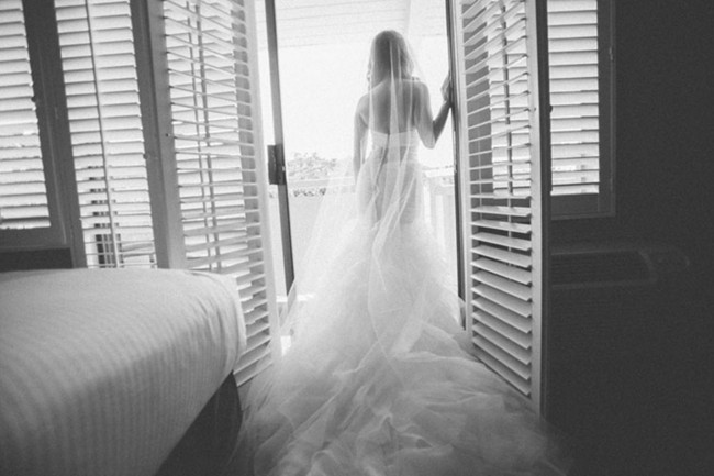 Black and white photo of bride in cathedral length veil
