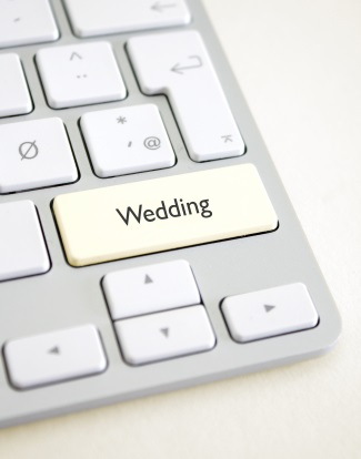 apple coputer with a wedding key on keyboard