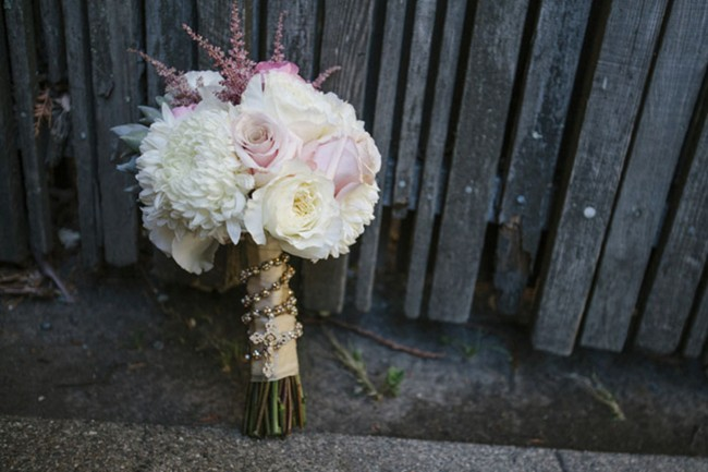 bouquet laying against old wood fence