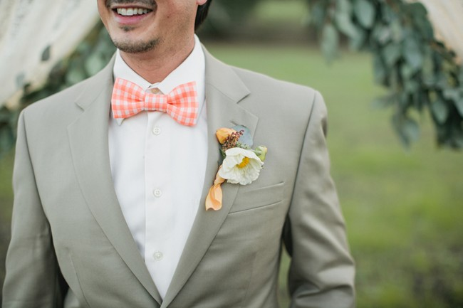 groom in peach striped bowtie and gray suit