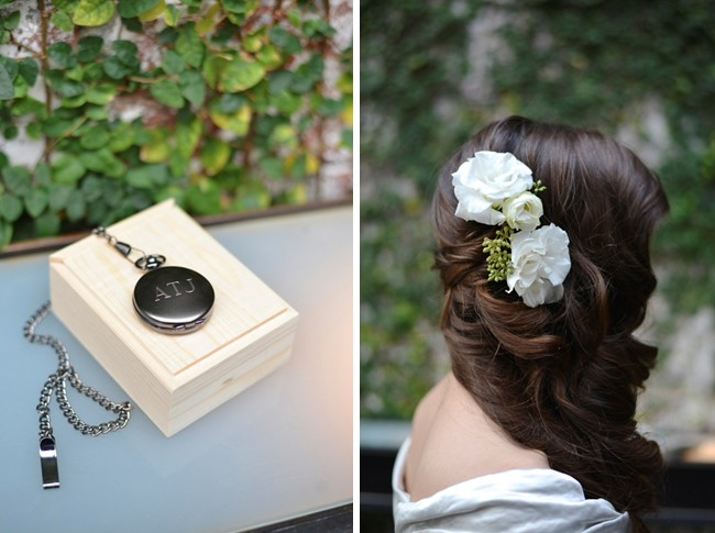 brides hair with white flowers. Pocket watch on wood box
