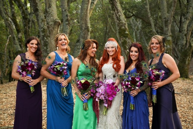 bridesmaids in different color dresses in the forest