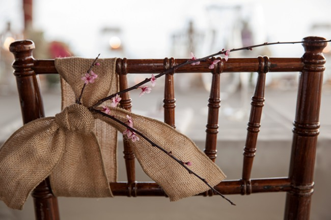 chair with burlap bow and cherry blossom branch