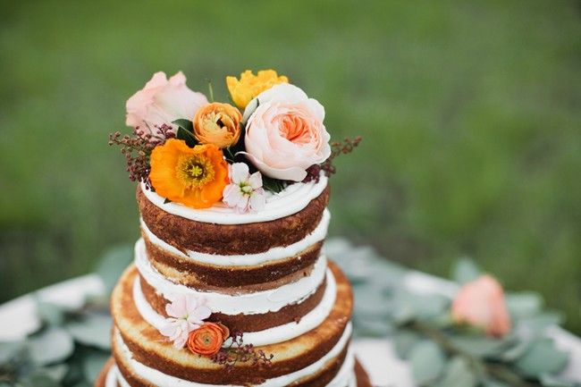 naked cake topped with flowers