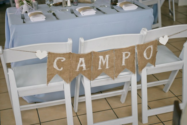 Bride and groom sign made out of burlap
