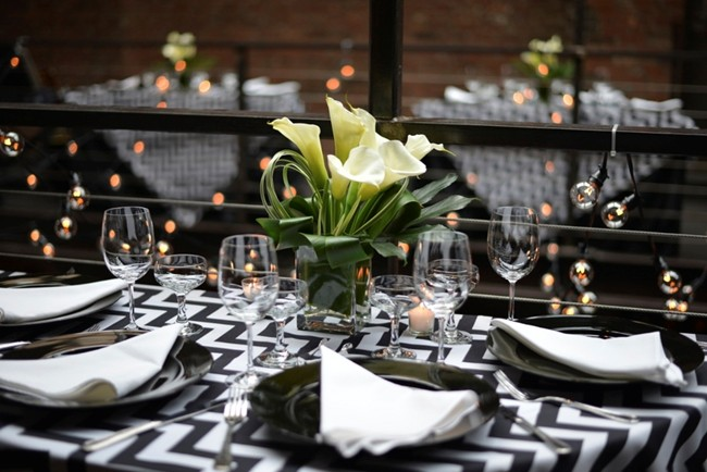 calla lilly centerpiece on black and white zig-zag tablecloth