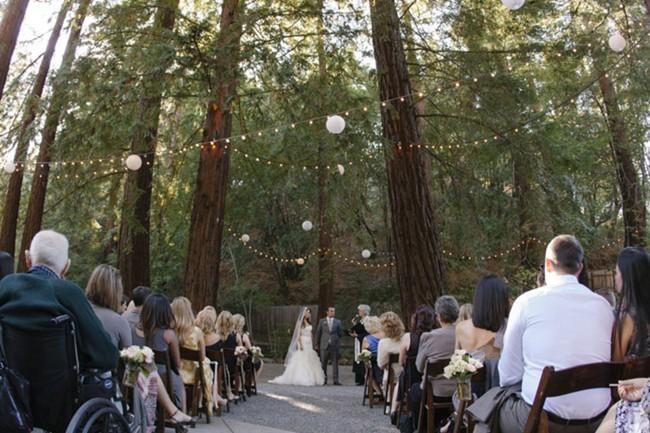 romantic rustic wedding ceremony among redwood trees