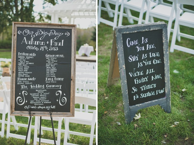 chalk board signs in front of the ceremony seating