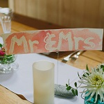 featred photo Mr &Mrs sign
