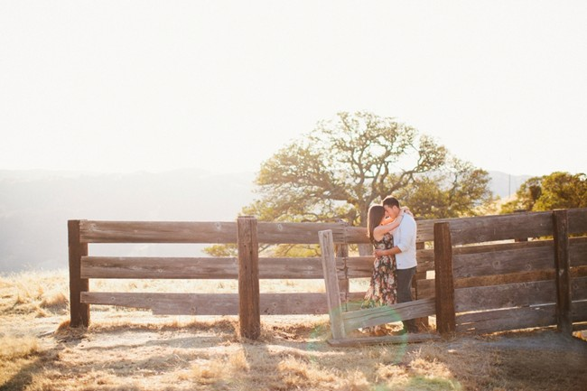 Couple embracing near fence