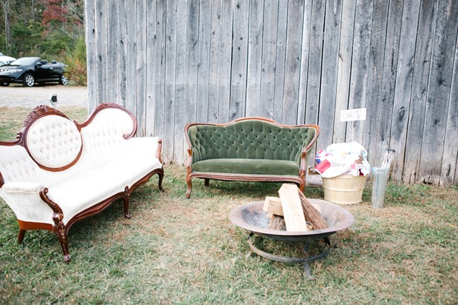 fire pit and vintage furniture outside barn